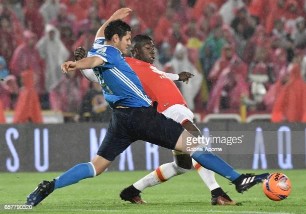 Jose Adolfo Valencia of Santa Fe struggles for the ball with Pedro Franco of Millonarios during the match between Santa Fe and Millonarios as part of...