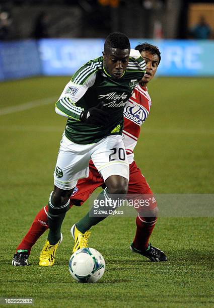 Jose Adolfo Valencia of the Portland Timbers moves past David Ferreira of FC Dallas during the first half of the game at JeldWen Field on February 20...