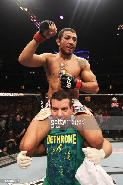 Jose Aldo celebrates defeating Mark Hominick by unanimous decision after 5 rounds in their Featherweight Championship bout at UFC 129 in the Rogers...