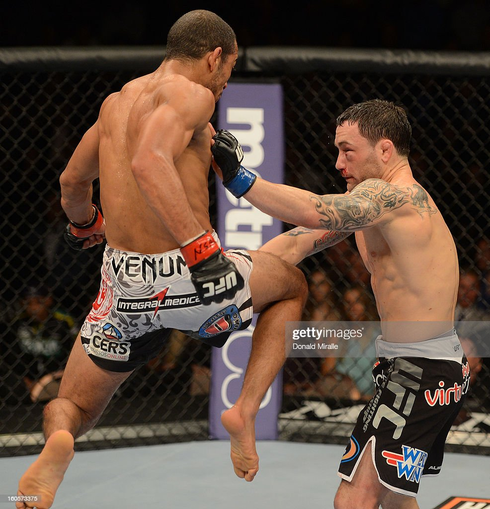 Jose Aldo (left) knees Frankie Edgar during their featherweight title fight at UFC 156 on February 2, 2013 at the Mandalay Bay Events Center in Las Vegas, Nevada.