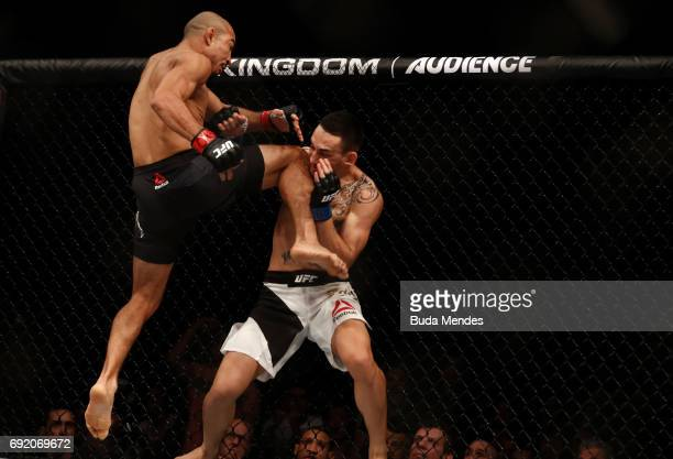 Jose Aldo of Brazil lands a flying knee against Max Holloway in their UFC featherweight championship bout during the UFC 212 event at Jeunesse Arena...