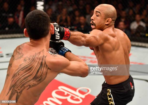 Jose Aldo of Brazil punches Max Holloway in their UFC featherweight championship bout during the UFC 212 event at Jeunesse Arena on June 3 2017 in...