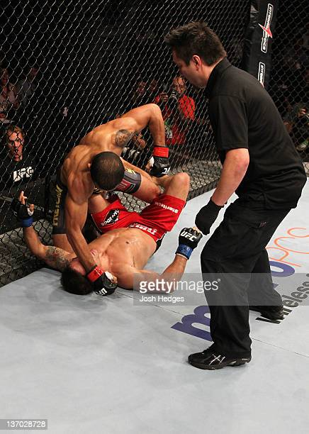 Jose Aldo punches Chad Mendes on the ground in a featherweight bout during UFC 142 at HSBC Arena on January 14 2012 in Rio de Janeiro Brazil