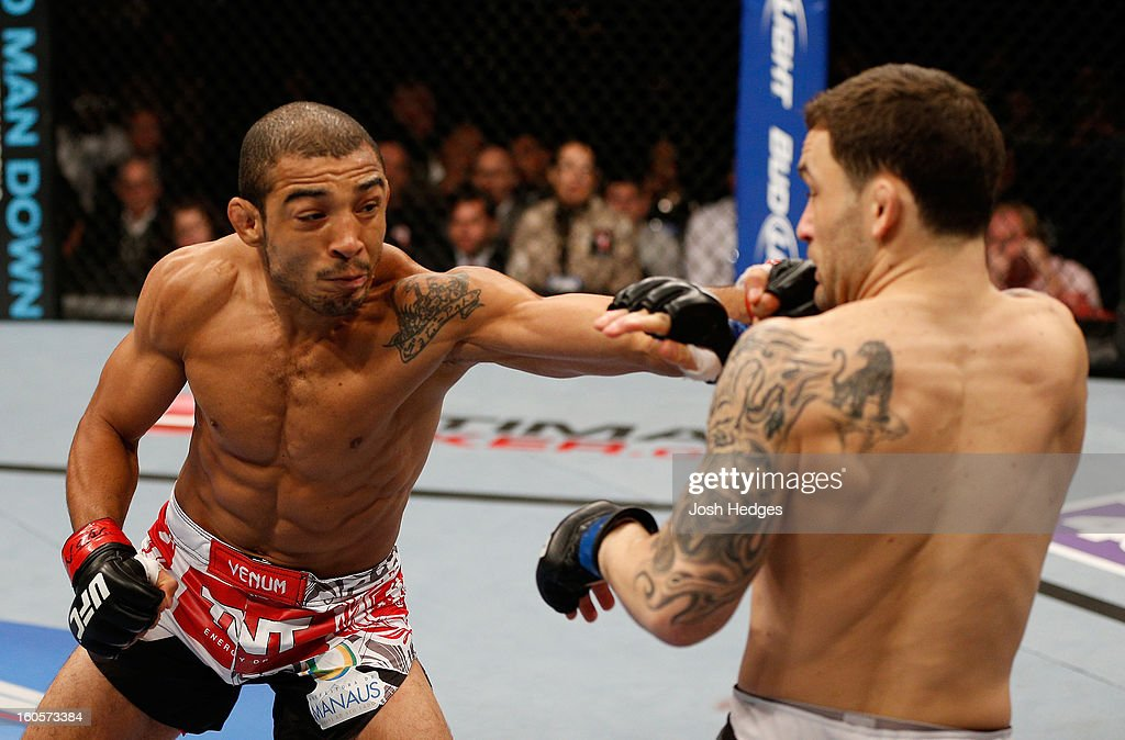 Jose Aldo (left) punches Frankie Edgar (right) during their featherweight title fight at UFC 156 on February 2, 2013 at the Mandalay Bay Events Center in Las Vegas, Nevada.