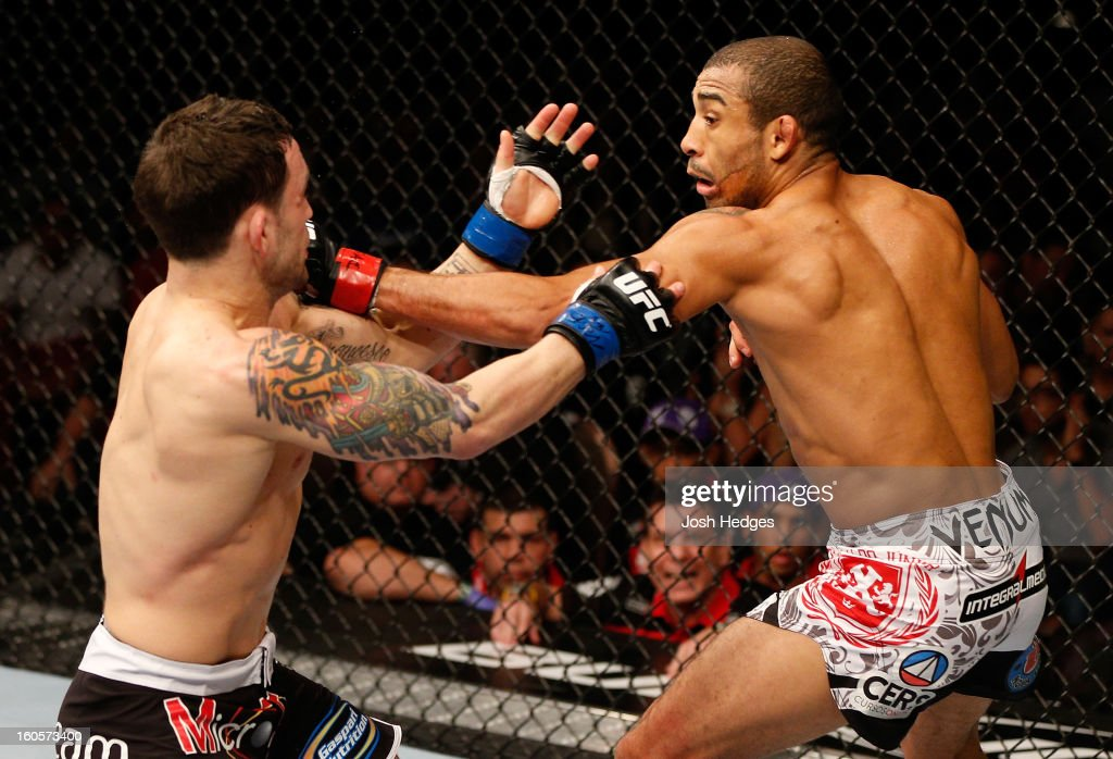 Jose Aldo punches Frankie Edgar during their featherweight title fight at UFC 156 on February 2, 2013 at the Mandalay Bay Events Center in Las Vegas, Nevada.