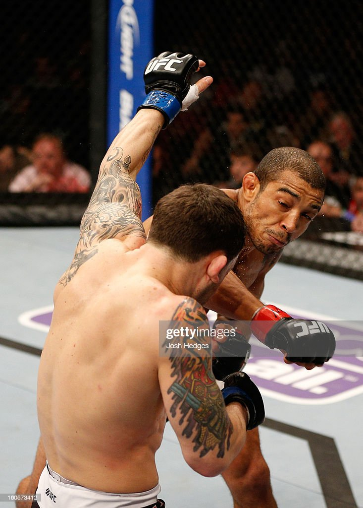 Jose Aldo (right) punches Frankie Edgar during their featherweight title fight at UFC 156 on February 2, 2013 at the Mandalay Bay Events Center in Las Vegas, Nevada.