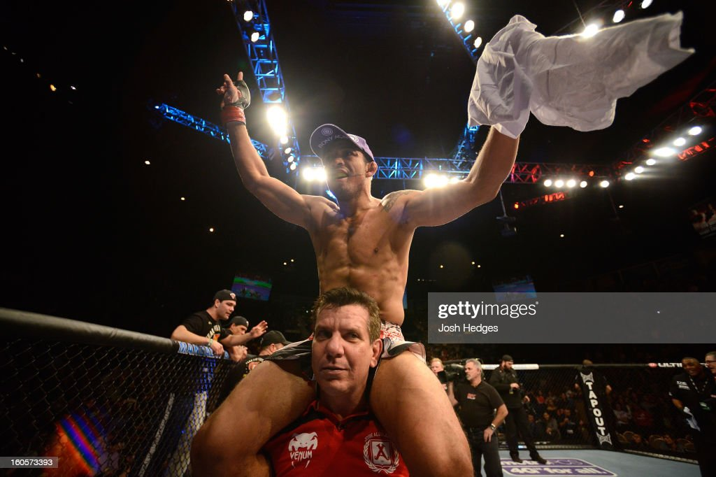 <a gi-track='captionPersonalityLinkClicked' href=/galleries/search?phrase=Jose+Aldo&family=editorial&specificpeople=6912631 ng-click='$event.stopPropagation()'>Jose Aldo</a> reacts to his victory over <a gi-track='captionPersonalityLinkClicked' href=/galleries/search?phrase=Frankie+Edgar&family=editorial&specificpeople=5446046 ng-click='$event.stopPropagation()'>Frankie Edgar</a> after their featherweight title fight at UFC 156 on February 2, 2013 at the Mandalay Bay Events Center in Las Vegas, Nevada.
