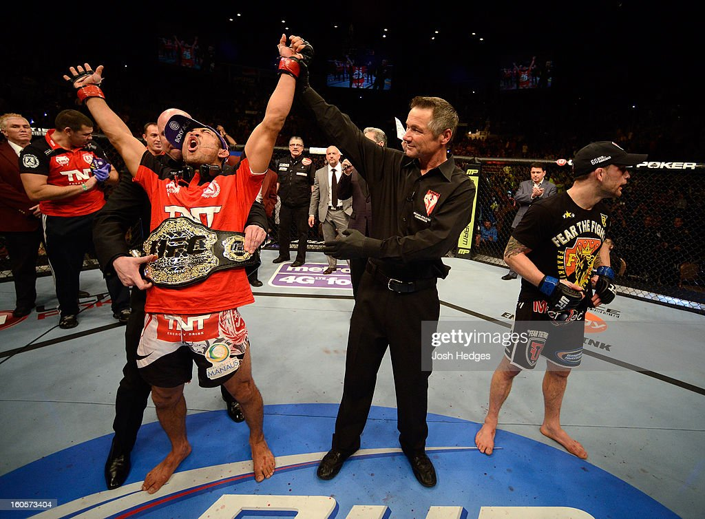 <a gi-track='captionPersonalityLinkClicked' href=/galleries/search?phrase=Jose+Aldo&family=editorial&specificpeople=6912631 ng-click='$event.stopPropagation()'>Jose Aldo</a> (left) reacts to his victory over <a gi-track='captionPersonalityLinkClicked' href=/galleries/search?phrase=Frankie+Edgar&family=editorial&specificpeople=5446046 ng-click='$event.stopPropagation()'>Frankie Edgar</a> (right) after their featherweight title fight at UFC 156 on February 2, 2013 at the Mandalay Bay Events Center in Las Vegas, Nevada.