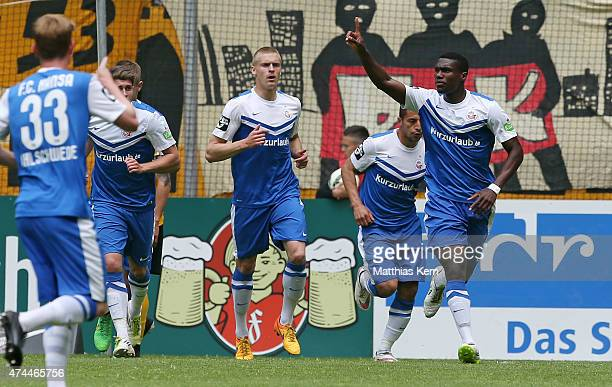 Jose Alex Mem Ikeng of Rostock jubilates after scoring the first goal during the third league match between SG Dynamo Dresden and FC Hansa Rostock at...
