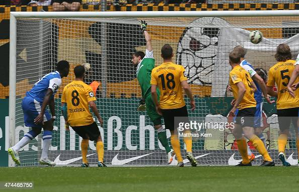 Jose Alex Mem Ikeng of Rostock scores the first goal during the third league match between SG Dynamo Dresden and FC Hansa Rostock at...