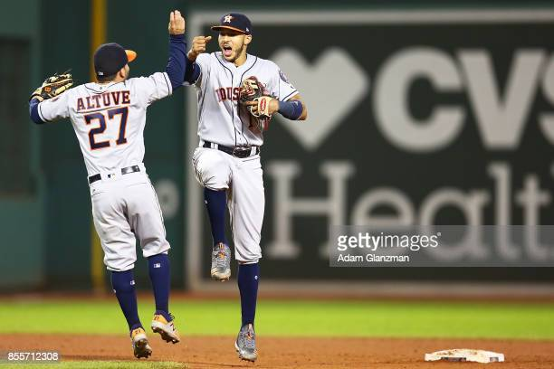 Jose Altuve and Carlos Correa of the Houston Astros celebrate after a victory over the Boston Red Sox at Fenway Park on September 29 2017 in Boston...