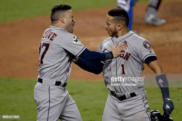 Jose Altuve and Carlos Correa of the Houston Astros celebrate after hitting solo home runs during the tenth inning against the Los Angeles Dodgers in...