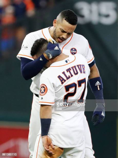 Jose Altuve and Carlos Correa of the Houston Astros celebrate their 2 to 1 win over the New York Yankees during game two of the American League...