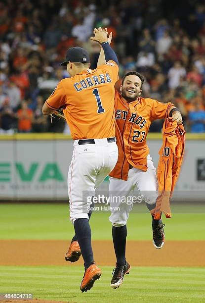 Jose Altuve and Carlos Correa of the Houston Astros celebrate with the jersey of Mike Fiers after Fiers tossed a nohitter en route to the Astros...