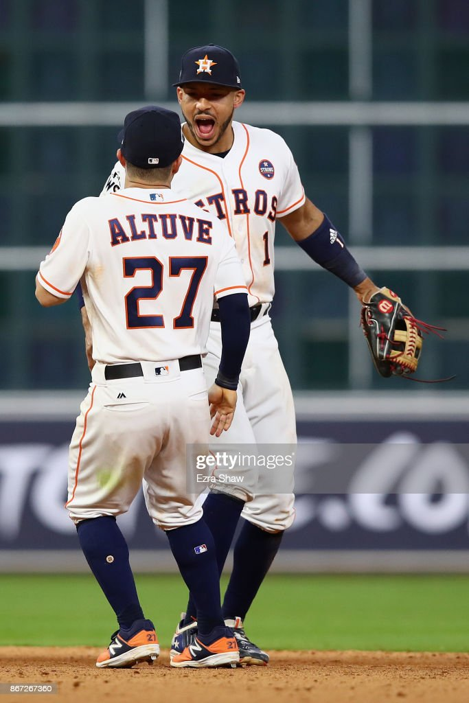 Jose Altuve #27 and Carlos Correa #1 of the Houston Astros react after defeating the Los Angeles Dodgers in game three of the 2017 World Series at Minute Maid Park on October 27, 2017 in Houston, Texas. The Astros defeated the Dodgers 5-3.