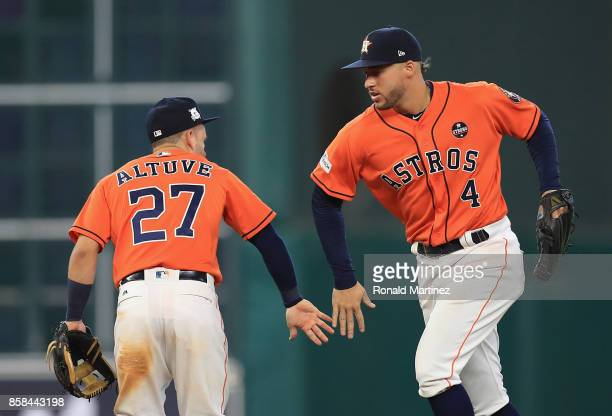 Jose Altuve and George Springer of the Houston Astros celebrate defeating the Boston Red Sox 82 in game two of the American League Division Series at...