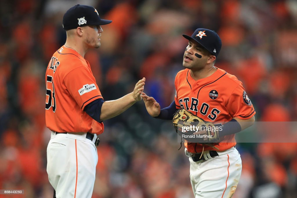 Jose Altuve #27 and Ken Giles #53 of the Houston Astros celebrate defeating the Boston Red Sox 8-2 in game two of the American League Division Series at Minute Maid Park on October 6, 2017 in Houston, Texas.