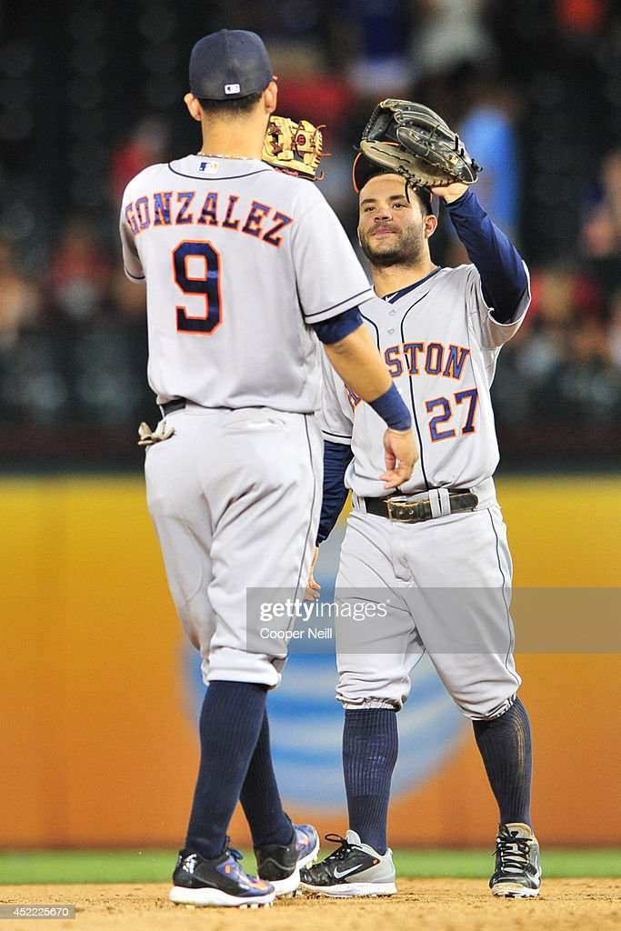 Jose Altuve and Marwin Gonzalez of the Houston Astros celebrate after defeating the Texas Rangers on July 9 2014 at Globe Life Park in Arlington in...