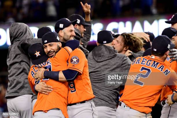 Jose Altuve Marwin Gonzalez and Alex Bregman of the Houston Astros celebrate defeating the Los Angeles Dodgers 51 in game seven to win the 2017 World...