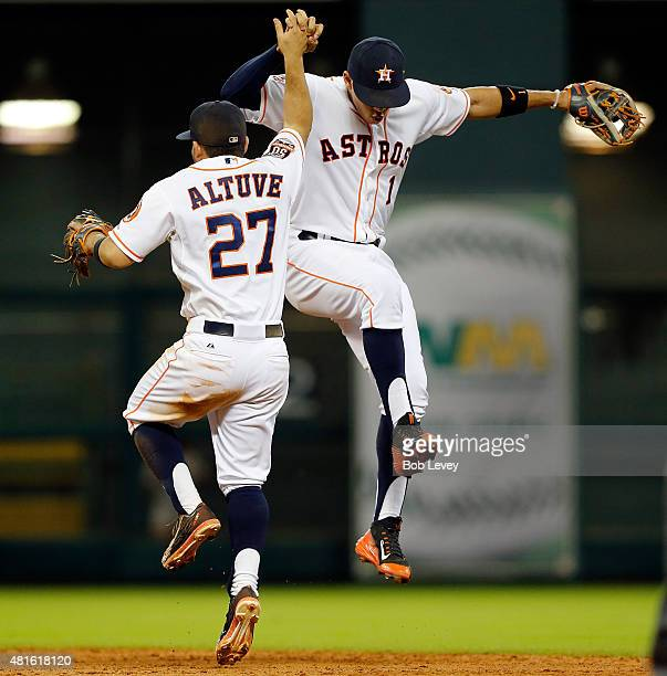 Jose Altuve of the Houston Astros and Carlos Correa celebrate after a 42 win over the Boston Red Sox at Minute Maid Park on July 22 2015 in Houston...