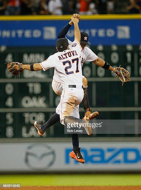 Jose Altuve of the Houston Astros and Carlos Correa celebrate after the final out against the Los Angeles Dodgers at Minute Maid Park on August 22...