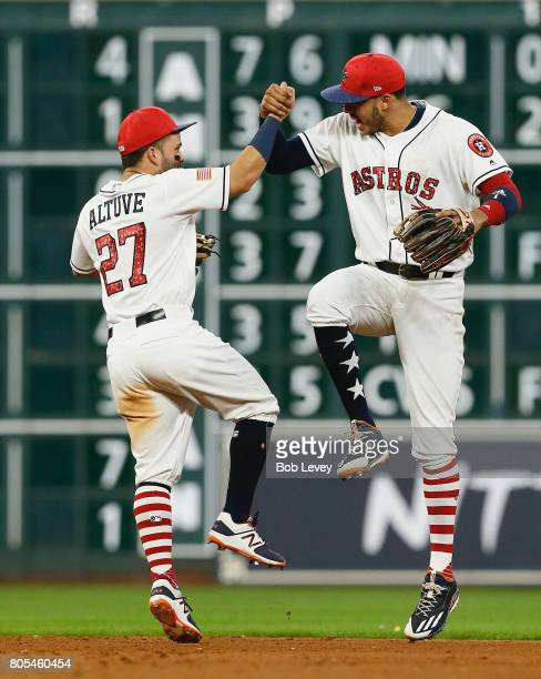 Jose Altuve of the Houston Astros and Carlos Correa celebrate after defeating the New York Yankees 76 at Minute Maid Park on July 1 2017 in Houston...