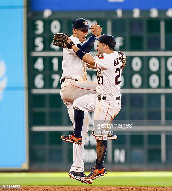 Jose Altuve of the Houston Astros and Carlos Correa celebrate their 32 win over the Los Angeles Angels of Anaheim at Minute Maid Park on June 22 2016...