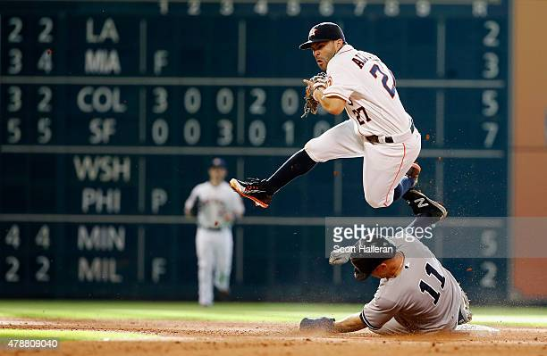 Jose Altuve of the Houston Astros cannot make a play on Brett Gardner of the New York Yankees at second base in the eighth inning during their game...