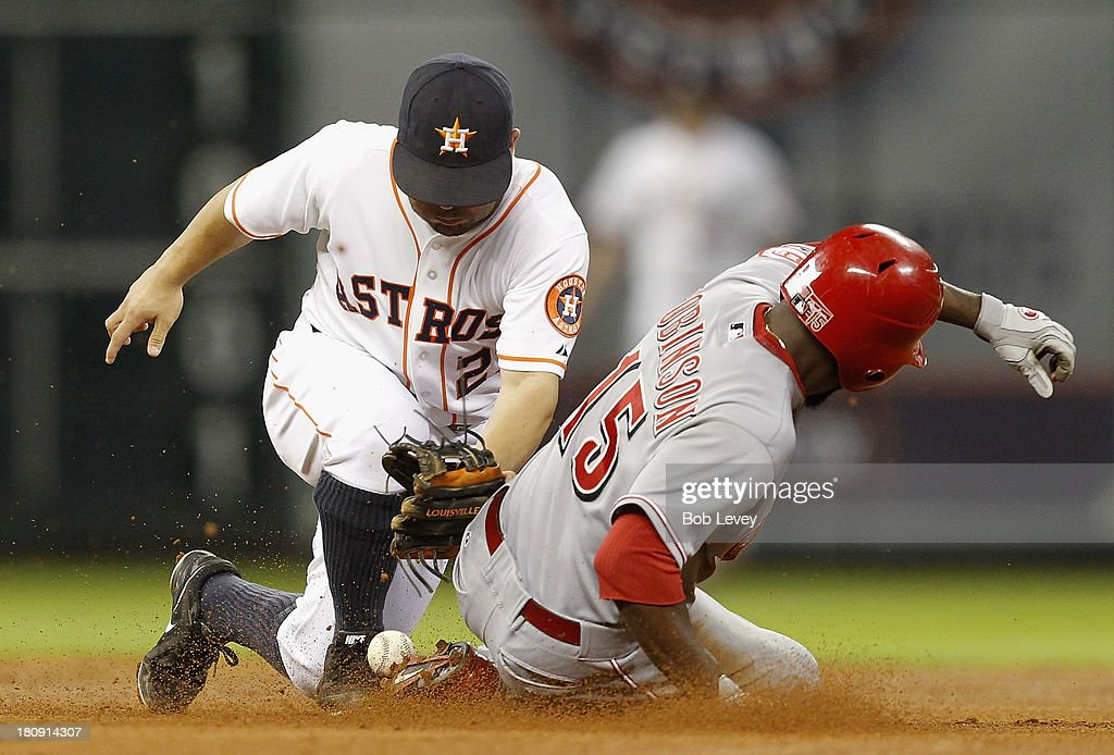 <a gi-track='captionPersonalityLinkClicked' href=/galleries/search?phrase=Jose+Altuve&family=editorial&specificpeople=7934195 ng-click='$event.stopPropagation()'>Jose Altuve</a> #27 of the Houston Astros can't handle the throw as Derrick Robinson #15 of the Cincinnati Reds sterals second base in the fourth inning at Minute Maid Park on September 17, 2013 in Houston, Texas.