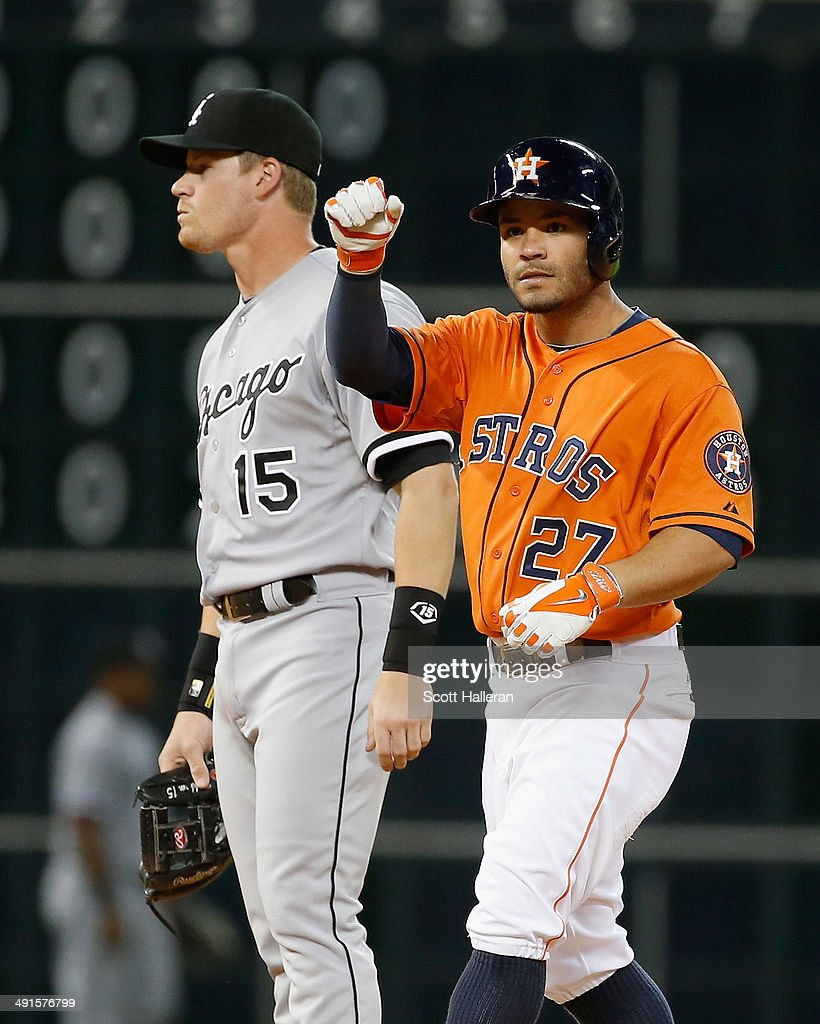 <a gi-track='captionPersonalityLinkClicked' href=/galleries/search?phrase=Jose+Altuve&family=editorial&specificpeople=7934195 ng-click='$event.stopPropagation()'>Jose Altuve</a> #27 of the Houston Astros celebrates after reaching second base in the fifth inning as <a gi-track='captionPersonalityLinkClicked' href=/galleries/search?phrase=Gordon+Beckham&family=editorial&specificpeople=5411079 ng-click='$event.stopPropagation()'>Gordon Beckham</a> #15 of the Chicago White Sox looks on during their game at Minute Maid Park on May 16, 2014 in Houston, Texas.