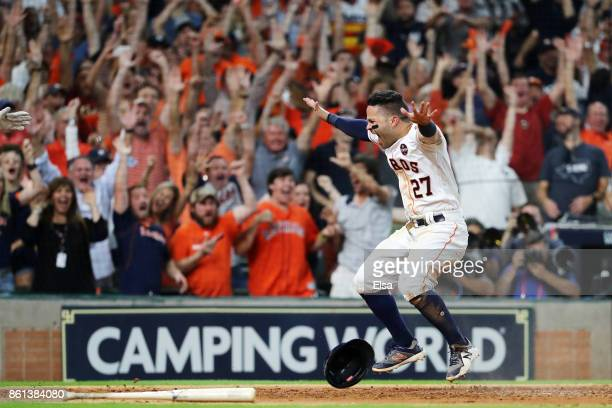 Jose Altuve of the Houston Astros celebrates after scoring the winning run in their 21 win over the New York Yankees during game two of the American...