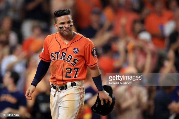Jose Altuve of the Houston Astros celebrates after sliding into home to score on a single by Carlos Correa in the fourth inning against the New York...