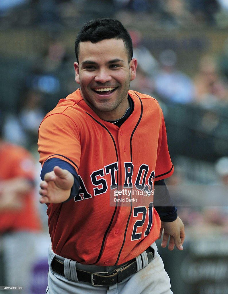 Jose Altuve #27 of the Houston Astros celebrates after the Astros scored against the Chicago White Sox during the seventh inning on July 20, 2014 at U.S. Cellular Field in Chicago, Illinois.