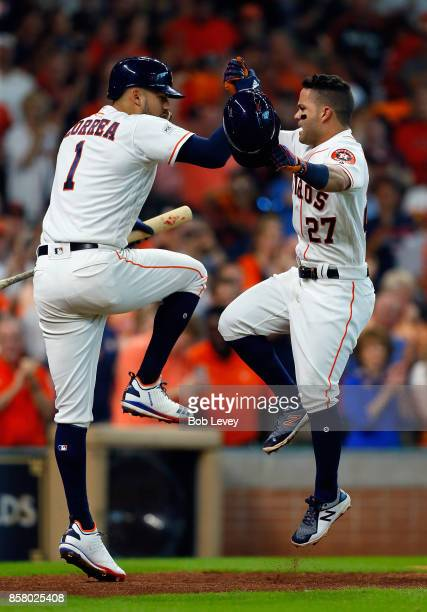 Jose Altuve of the Houston Astros celebrates with Carlos Correa after hitting a home run in the fifth inning against the Boston Red Sox during game...