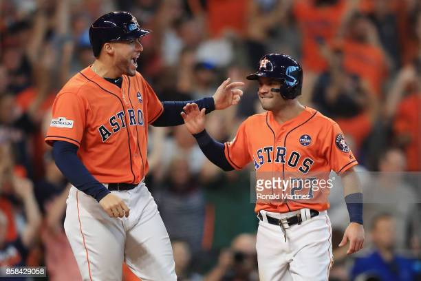 Jose Altuve of the Houston Astros celebrates with George Springer after scoring a run in the sixth inning against the Boston Red Sox during game two...