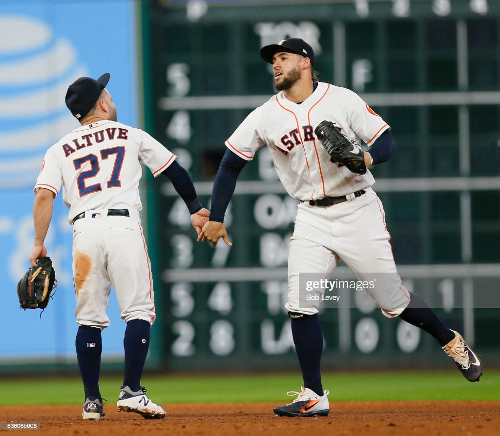Jose Altuve #27 of the Houston Astros celebrates with George Springer #4 after the final out against the Washington Nationals at Minute Maid Park on August 23, 2017 in Houston, Texas.