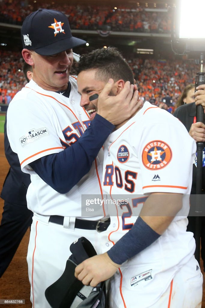 Jose Altuve #27 of the Houston Astros celebrates with manager A.J. Hinch #14 after defeating the New York Yankees by a score of 4-0 to win Game Seven of the American League Championship Series at Minute Maid Park on October 21, 2017 in Houston, Texas. The Houston Astros advance to face the Los Angeles Dodgers in the World Series.