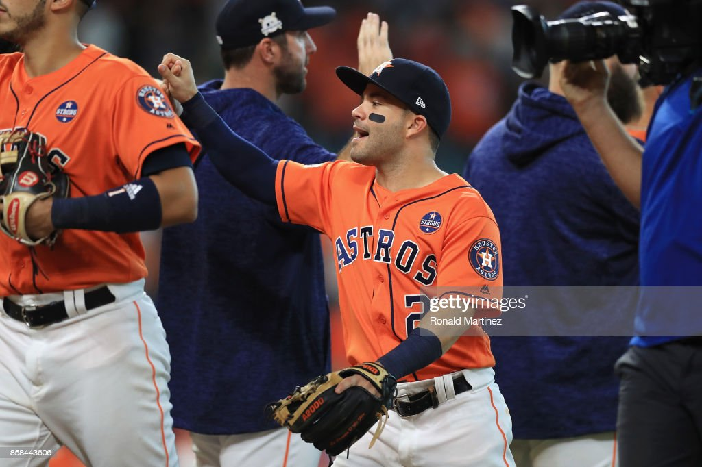 Jose Altuve #27 of the Houston Astros celebrates with teammates after defeating the Boston Red Sox 8-2 in game two of the American League Division Series at Minute Maid Park on October 6, 2017 in Houston, Texas.