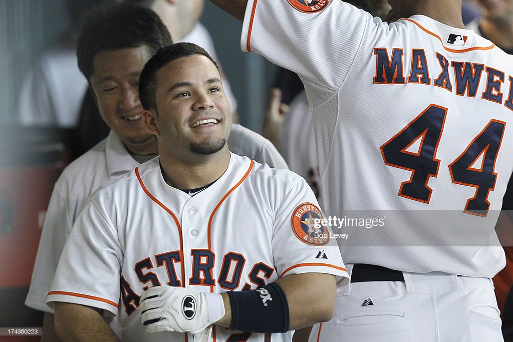 Jose Altuve #27 of the Houston Astros checks the video board after hitting a home run in the fourth inning against the Oakland Athletics at Minute Maid Park on July 24, 2013 in Houston, Texas.