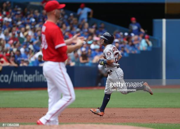 Jose Altuve of the Houston Astros circles the bases after hitting a tworun home run in the second inning during MLB game action as JA Happ of the...