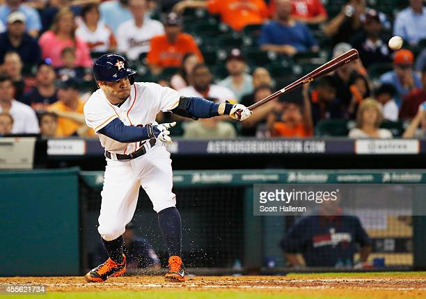 Jose Altuve of the Houston Astros connects on an infield single during the fourth inning against the Cleveland Indians during their game at Minute...