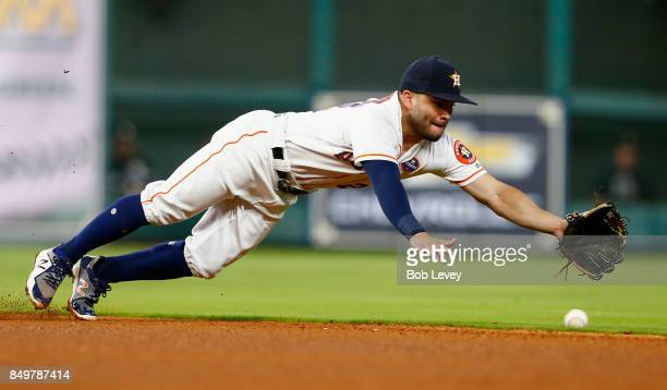 Jose Altuve of the Houston Astros dives for a ground ball hit by Avisail Garcia of the Chicago White Sox in the fourth inning at Minute Maid Park on...