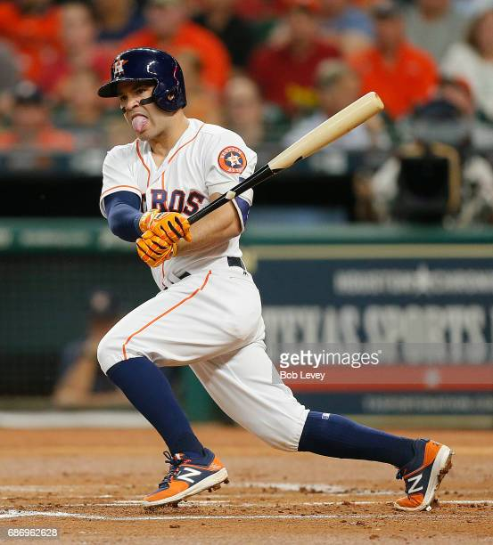 Jose Altuve of the Houston Astros doubles in a run in the first inning against the Detroit Tigers at Minute Maid Park on May 22 2017 in Houston Texas