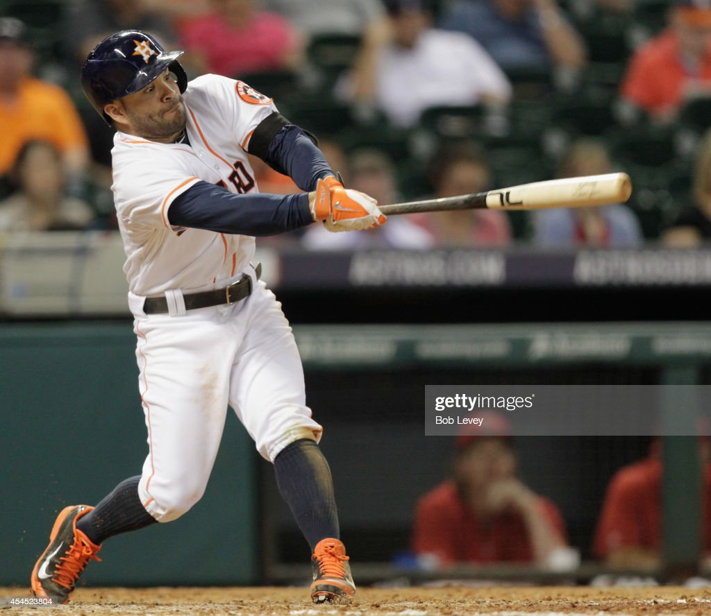<a gi-track='captionPersonalityLinkClicked' href=/galleries/search?phrase=Jose+Altuve&family=editorial&specificpeople=7934195 ng-click='$event.stopPropagation()'>Jose Altuve</a> #27 of the Houston Astros doubles in the eighth inning against the Los Angeles Angels of Anaheim at Minute Maid Park on September 2, 2014 in Houston, Texas.