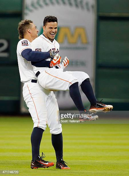 Jose Altuve of the Houston Astros gets a hug from George Springer after Aluve's tenth inning gamewinning RBI single to defeat the Seattle Mariners 32...
