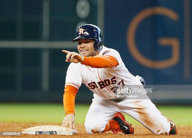 Jose Altuve of the Houston Astros gets caught stealing at second base during the sixth inning of their game against the Seattle Mariners at Minute...