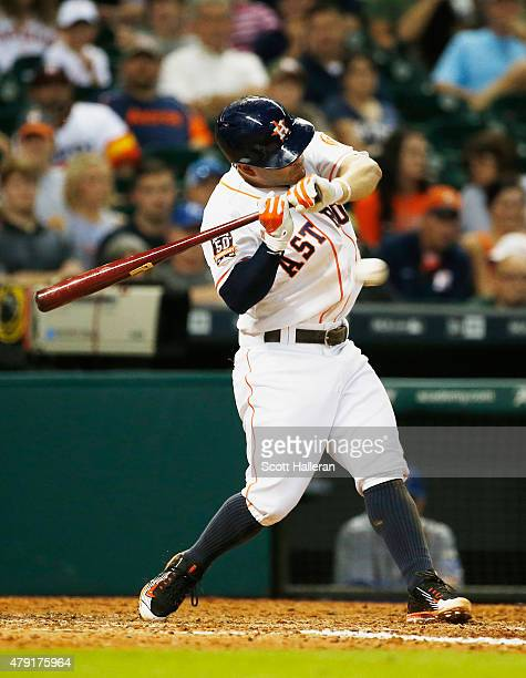 Jose Altuve of the Houston Astros gets hit by a pitch against the Kansas City Royals in the seventh inning during their game at Minute Maid Park on...