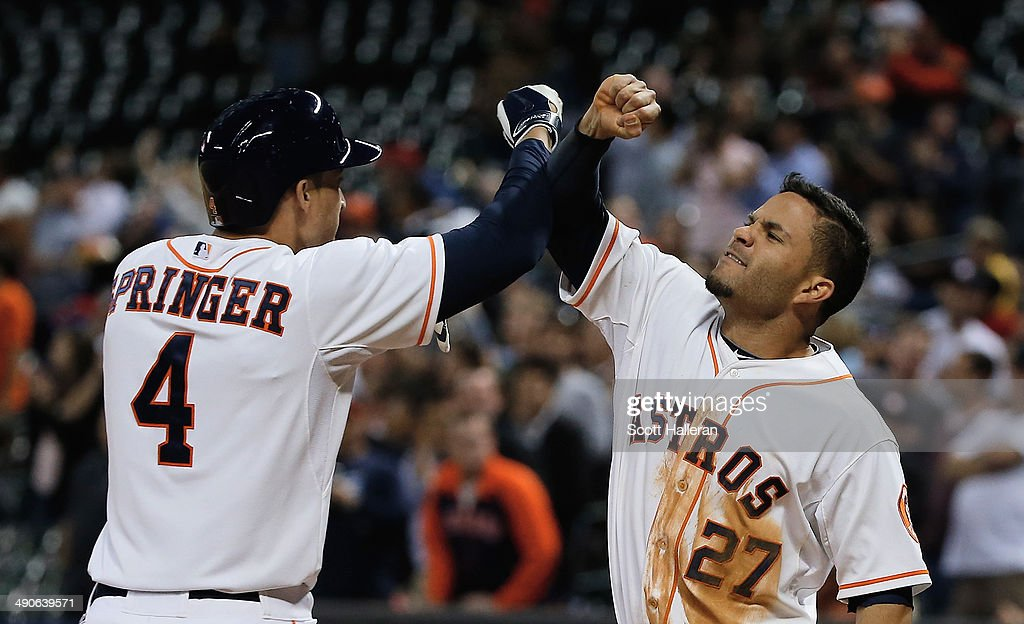 <a gi-track='captionPersonalityLinkClicked' href=/galleries/search?phrase=Jose+Altuve&family=editorial&specificpeople=7934195 ng-click='$event.stopPropagation()'>Jose Altuve</a> #27 of the Houston Astros (R) greets <a gi-track='captionPersonalityLinkClicked' href=/galleries/search?phrase=George+Springer&family=editorial&specificpeople=8060257 ng-click='$event.stopPropagation()'>George Springer</a> #4 after Springer hit a two-run home run in the seventh inning of their game against the Texas Rangers at Minute Maid Park on May 14, 2014 in Houston, Texas.
