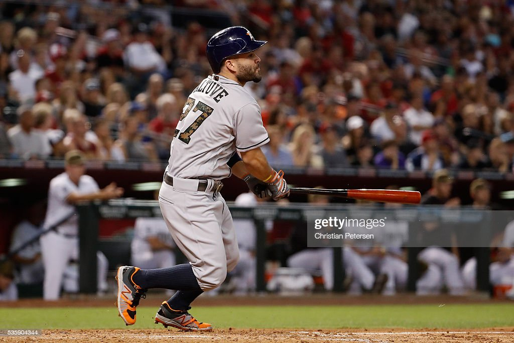 Jose Altuve #27 of the Houston Astros hits a RBI single against the Arizona Diamondbacks during the second inning of the MLB game at Chase Field on May 30, 2016 in Phoenix, Arizona.
