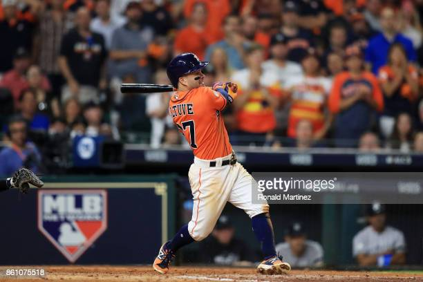Jose Altuve of the Houston Astros hits a single in the eighth inning against the New York Yankees during game one of the American League Championship...
